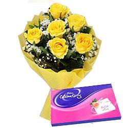 Adorable Yellow Rose Hand Bunch and Cadbury Assortment Chocolates