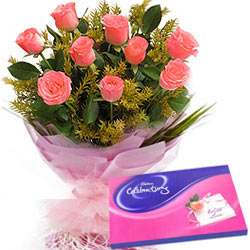 Gaudy Pink Roses Hand Bunch with Cadbury Assortment