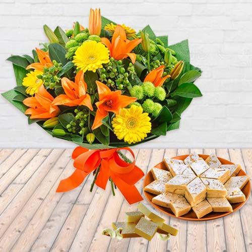 Beautiful fresh Seasonal Flower and delectable Kaju Barfi