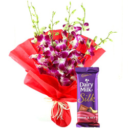 Special Anniversary Surprise Bouquet of Orchids and Cadbury Silk