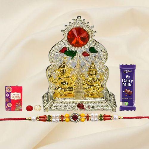 Silver Plated Mandap with Golden Ganesh Laxmi Idol and Cadbury Dairy Milk Chocolate with Rakhi and Roli Tilak Chawal