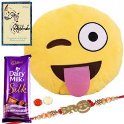Smiley Cushion with Smiley Bro Rakhi and Cadbury Dairy Milk Silk Bar & a Rakhi Card with Roli Tilak and Chawal