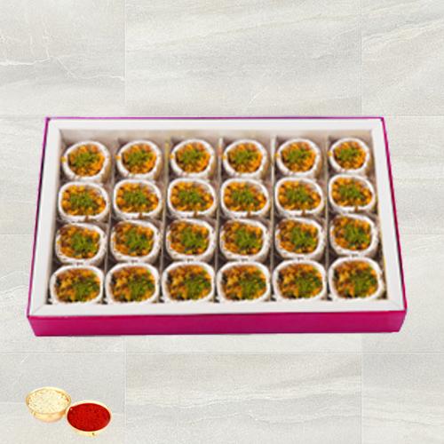 Kaju Pista Premium Sweets from Haldiram with free Roli Tilak and Chawal.