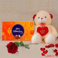 Cadburys Celebration Pack with a silk rose and  A 12 inch Cute Teddy Bear.