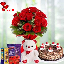 12 Exclusive  Dutch Red  Roses  Bouquet with Cake , Cadburys Assorted Chocolates and  a Cute Teddy Bear