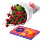 Delightful Cluster of Roses and Chocolates to Bakaram