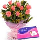 Gaudy Pink Roses Hand Bunch with Cadbury Assortment to Hyderabad City Bus Station