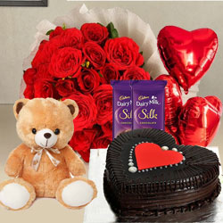 Breathtaking Red Roses, Chocolate Cake, Mylar Balloons, Chocolates and a Teddy