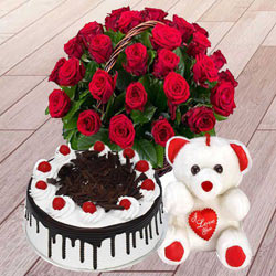Thrilling 25 Red Roses with 1 Lb Black Forest Cake and a Teddy Bear