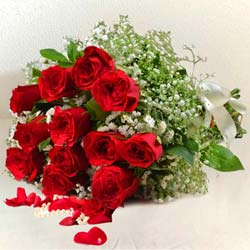 Luminous Bouquet of 12 Red Roses for Sweet Surprise to Vanastalipuram