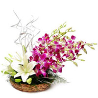 Heavenly Basket Arrangement of White Lilies nd Orchids