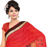 Glamorous Fire Orange, Cream and Brown Coloured Georgette Printed Saree