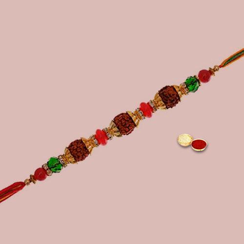 Enticing Gift of Rudraksh Rakhi with Roli Tika Chawal