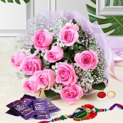 Jubilant Assort of Flowerets and Comfits With Rakhi