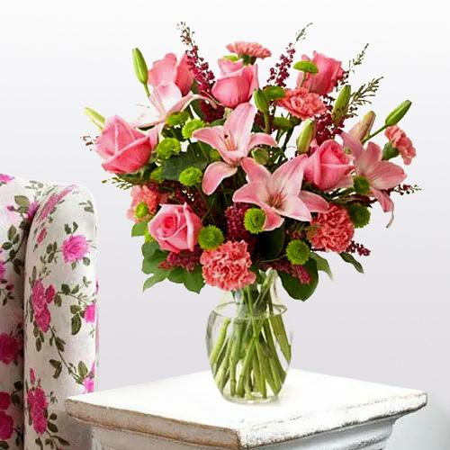 Deliver Online Lilies, Roses and Carnations Arrangement in a Glass Vase