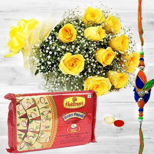 Romantic Morning Yellow Roses Glory with 200 gms. Soan Papdi and one pc. Rakhi