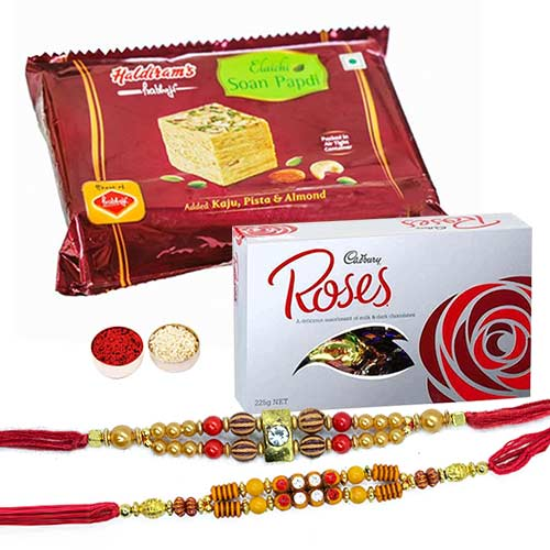 Pretty Rakhi with Cadbury Roses N Soan Papdi