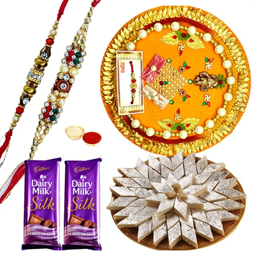 Wonderful Pooja Thali, Yummy Kaju Katli, Gift Voucher from Pantaloons with 2 free Rakhi, Roli Tilak and Chawal