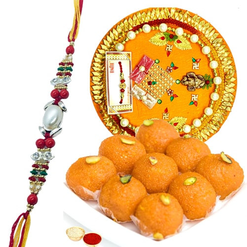 Laddoo and Designer Pooja Thali along Rakhi, Roli, Tilak and Chawal