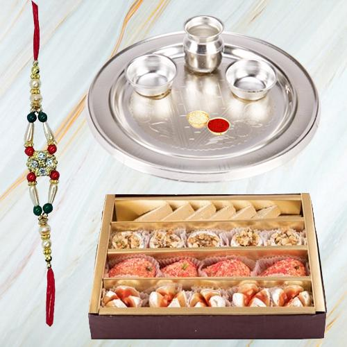 Assorted Sweets and Stylish and Trendy looking Silver Plated Paan Shaped Puja Aarti Thali along Rakhi, Roli, Tilak and Chawal